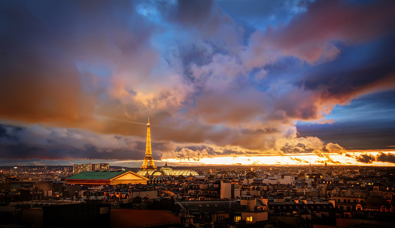 "<h2>The Amazing Eiffel Tower in Romantic Paris</h2> <br/>I shot this just recently with Tom Anderson. We almost didn't leave the hotel because it was so stormy, but we had been watching the clouds all day. We started out with Miss Aniela at the Paris Opera before exploring the rest of the city. Sunset comes early here around this time of the year (about 5 PM or so), and it always sneaks up on us.<br/><br/>Some of the best sunsets come right after storms… so it's always worth a little adventure if you don't mind getting a little wet… <br/><br/>- Trey Ratcliff<br/><br/><a href=""http://www.stuckincustoms.com/2012/11/27/what-prints-hang-in-my-home/"" rel=""nofollow"">Click here to read the rest of this post at the Stuck in Customs blog.</a>"
