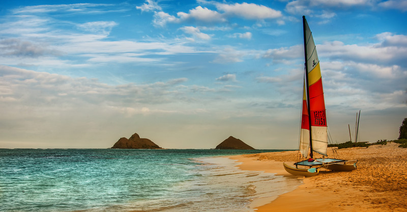 "<h2>Boat on Oahu Beach</h2><br/>You can drive along the beach for hours and hours in Oahu but miss what is actually there. Often times, there is a row of trees or houses that block the actual beach, but it's hard to know what is just on the other side!<br/><br/>Luckily, Tom and I walked through some of the fauna and found this scene. It was all set up so perfect — and there I was with my camera (which isn't THAT much of a surprise).<br/><br/>- Trey Ratcliff<br/><br/><a href=""http://www.stuckincustoms.com/2012/07/05/win-a-sony-nex-7-nikon-d7000-or-canon-60d/"" rel=""nofollow"">Click here to read the entire post at the Stuck in Customs blog.</a>"