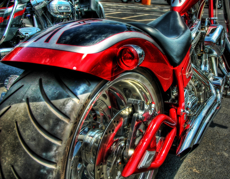 "<h2>The Red Hiney, Presenting</h2> <br/>One of the phattest rear tires I've seen.<br/><br/>- Trey Ratcliff<br/><br/><a href=""http://www.stuckincustoms.com/2006/07/04/many-more-motorcycles/"" rel=""nofollow"">Click here to read the rest of this post at the Stuck in Customs blog.</a>"