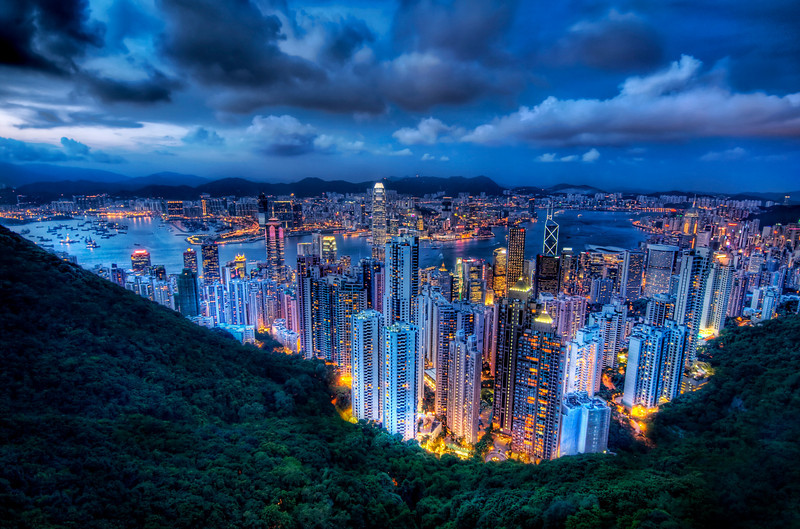 """<h2>The Megopolis Hong Kong - What Happens Around Dusk</h2> <br/>Believe it or not, there is a small documentary being filmed about me.  I don't know what to think about it - only to assume it is going to be rather boring!  I think it is going to be a lot like Grizzly Man, just without the bear.<br/><br/>As this gal is going about her process of gathering materials, she asked me for a few of the original shots from Hong Kong so she can show them during the documentary.  I was going back through my old shots, and found that I had never processed THIS one of Hong Kong, which has a really moody dusk sky, so I spent a few hours to clean it up for publication.<br/><br/>- Trey Ratcliff<br/><br/><a href=""""http://www.stuckincustoms.com/2008/11/08/the-megopolis-hong-kong-what-happens-around-dusk/"""" rel=""""nofollow"""">Click here to read the rest of this post at the Stuck in Customs blog.</a>"""