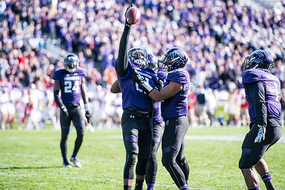 Northwestern's Kyle Queiro celebrates his interception with teammates October, 2016