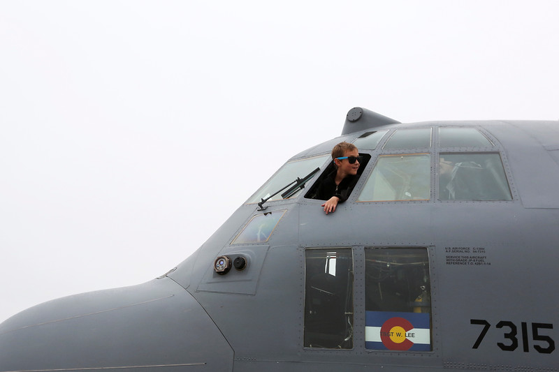 Easton West, 8, peaks out of the cockpit of a C-130 on the tarmac of the Pikes Peak Regional Airshow on Saturday, Sept. 23, 2017. The C-130 and a Chinook helicopter were both open for visitors to explore and had long lines, even after the rain started.<br /> <br /> (The Gazette, Nadav Soroker)