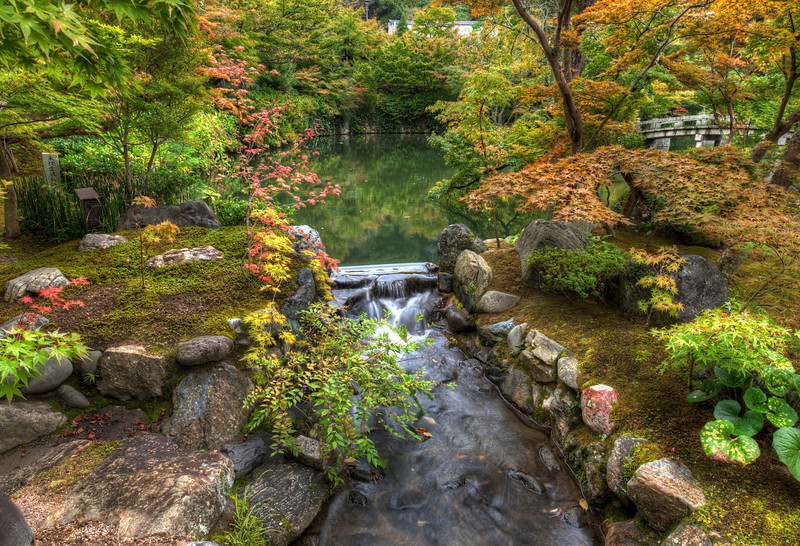 "<h2>The Harmony Garden</h2> <br/> Kyoto was filled with thousands of these tiny gardens with ponds and little rivers.  Which one to take photos of first?!?<br/><br/>None of them seemed to have artificial pumps that moved the water around.  I always think of that whenever I see little gardens with water features in the states, or like they sell at Sam's.  Somehow, it seems, Japanese garden-masters are able to constantly refill their ponds by keeping the appropriate amount of dew forming on surrounding leaves, which then drips into the pond, which then goes down a perfect little waterfall, and ends up at another perfect pond about 50 paces away.<br/><br/>- Trey Ratcliff<br/><br/><a href=""http://www.stuckincustoms.com/2010/02/21/the-harmony-garden/"" rel=""nofollow"">Click here to read the rest of this post at the Stuck in Customs blog.</a>"