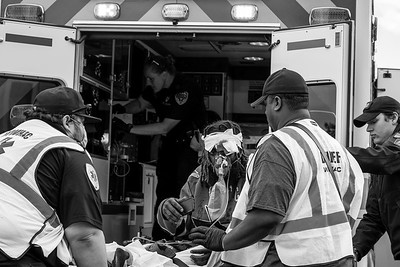 A man shot in the head is rushed to an ambulance in Wyandanch as EMT's and Paramedics work to control bleeding and keep him alive. 06-01-2020