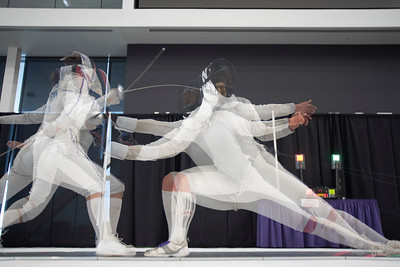 A multiple exposure of two fencers competing in the 2019 Remenyik Open at Northwestern University in Evanston, Illinois on Saturday, October 12, 2019. | Colin Boyle/Northwestern Athletics