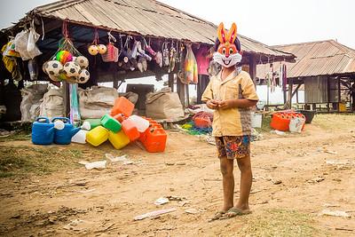 Child with creepy bunny mask. Sankar village, Inle Lake, Myanmar.