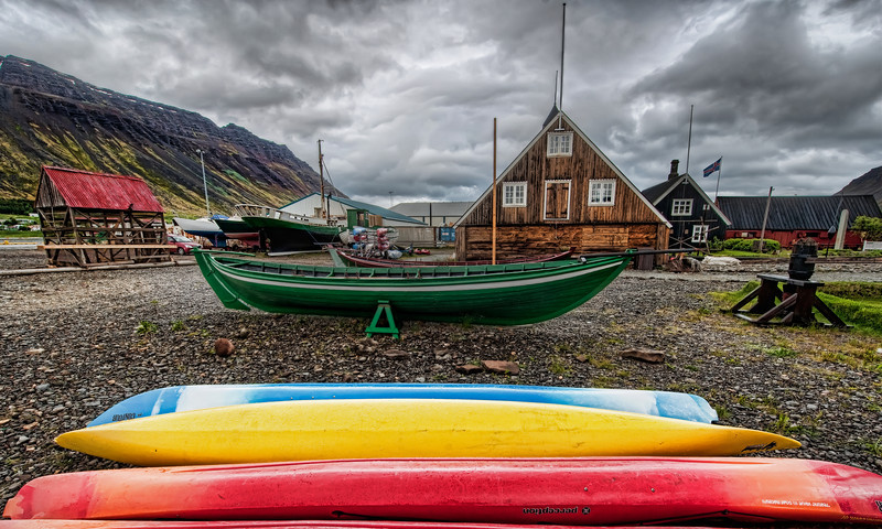 "<h2>The Best Fish Evar</h2> <br/>I have a restaurant suggestion! <br/><br/>The best fish I have ever had is in that little viking-house there to the right. You have to duck to get through the door. Once inside, you emerge into a darkened viking-style dining hall (imagine the great hall where Gríma Wormtongue held powah over King Théoden of Rohan).<br/><br/>This spot is pretty well-known restaurant called Tjöruhúsið in the little town of Isafjordur. There is a little window in the back where the fishermen come every morning to deliver the fresh fish in exchange for getting to eat there for free. They bring you the food inside giant iron-clad pans… it was so awesome. I'm going back in a few months and I'm going to gorge myself here with giant dinners before heading out for all-night shooting.<br/><br/>- Trey Ratcliff<br/><br/><a href=""http://www.stuckincustoms.com/2011/04/23/the-best-fish-evar/"" rel=""nofollow"">Click here to read the rest of this post at the Stuck in Customs blog.</a>"