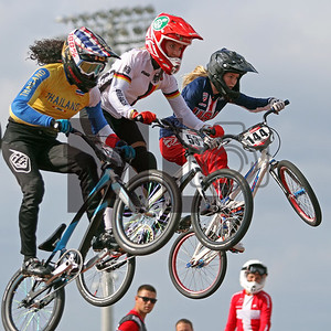 Amanda Carr of Thailand, Nadja Pries of Germany and Daleny Vaughn of the U.S. race at the UCI BMX Supercross World Cup Round 8 at Rock Hill, S.C., on Saturday, Sept. 14, 2019.