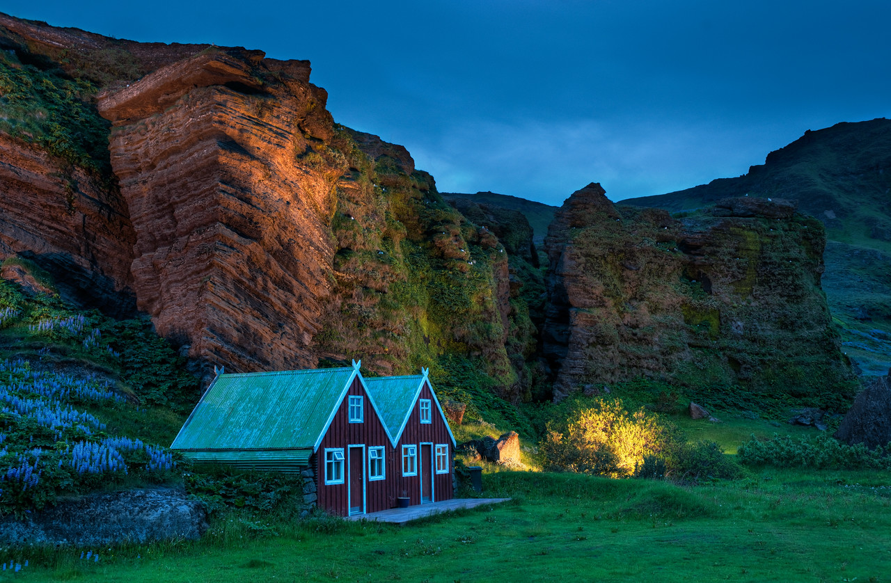 """The Cavebirds in the Gentle Evening How awesome is his little gem in Iceland? It's a small town not too far from that big volcano called """"Vik"""".  It is the home to many different birds, and a lot of them nest inside these tiny caves in the cliff walls.  In this area just north of the town, the local residents decided to light the side of the cliff at night to give it a special feel. - Trey Ratcliff The rest of this entry is here at the Stuck in Customs blog."""