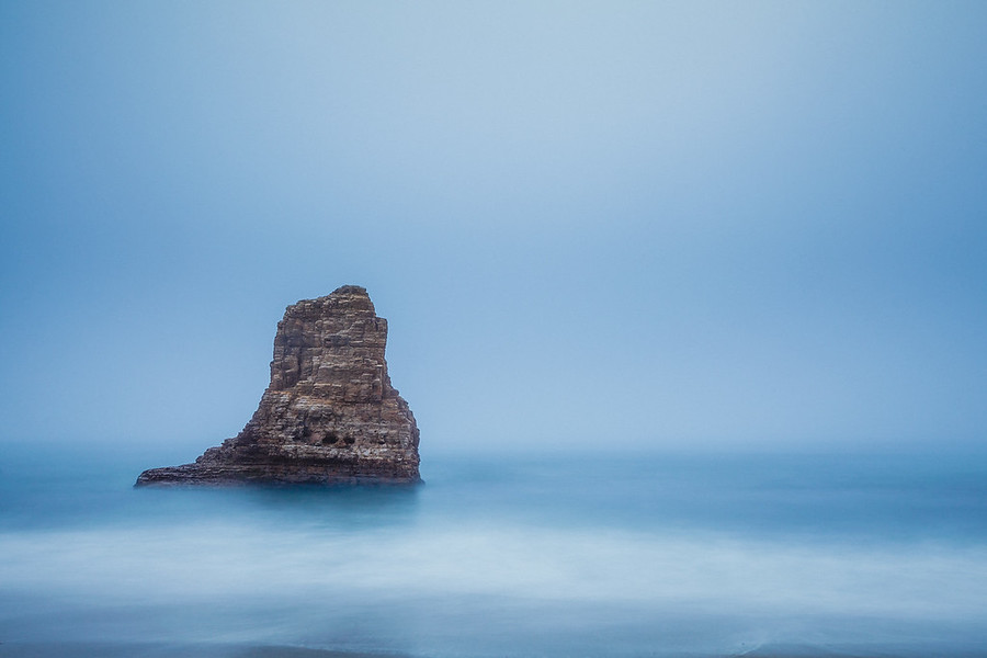 Beacon at Davenport Beach. A beacon like rock taken during a foggy night at Davenport Beach near Santa Cruz.