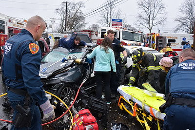 Multiple fire departments, Suffolk County Police ESU, and Amityville Police work to free several injured people pinned in their vehicles following a multiple car auto accident. 03-28-2017