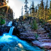 "<h2>A Canyon Oasis</h2> <br/>This place is deep inside Glacier National Park.  The only bad thing about photography is I can't show how deafening the sound of the waterfall inside the canyons was!  It ricocheted around the rocky walls and seemed to be perfectly acoustic echo chamber.  I didn't get in, but the water seemed super-cold.  It was a nice spot to stop and take a break for a bit.  You would think the noise would kind of relaxing, but it was less of the alarm-clock-bubbling-brook and more of the 747-emergency-landing...<br/><br/>- Trey Ratcliff<br/><br/><a href=""http://www.stuckincustoms.com/2009/04/24/a-canyon-oasis/"" rel=""nofollow"">Click here to read the rest of this post at the Stuck in Customs blog.</a>"