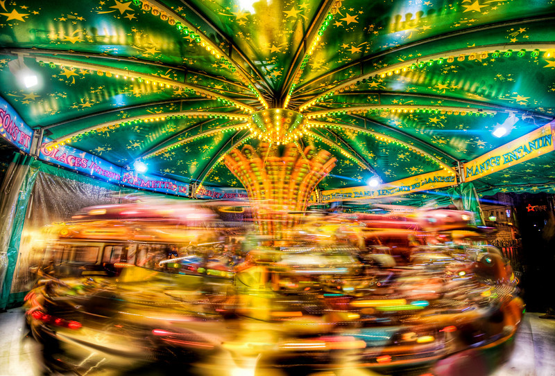 "<h2>A Small Carousel in France</h2> <br/>If you want to see how I made this (and how you can too!), visit my HDR Tutorial. I hope it gives you some new tricks!<br/><br/>It was just past 10 PM on the wet streets of Paris as I was getting lost on purpose around the streets near the Church of the Sacred Heart. I bobbed and weaved through various little alleys, streets, and tiny bakeries (where I would just have to stop for a moment), before finding my way to this little faire. There was a small carousel spinning away with tiny little French children screaming wonderful things...<br/><br/>- Trey Ratcliff<br/><br/><a href=""http://www.stuckincustoms.com/2008/07/31/a-small-carousel-in-a-france/"" rel=""nofollow"">Click here to read the rest of this post at the Stuck in Customs blog.</a>"