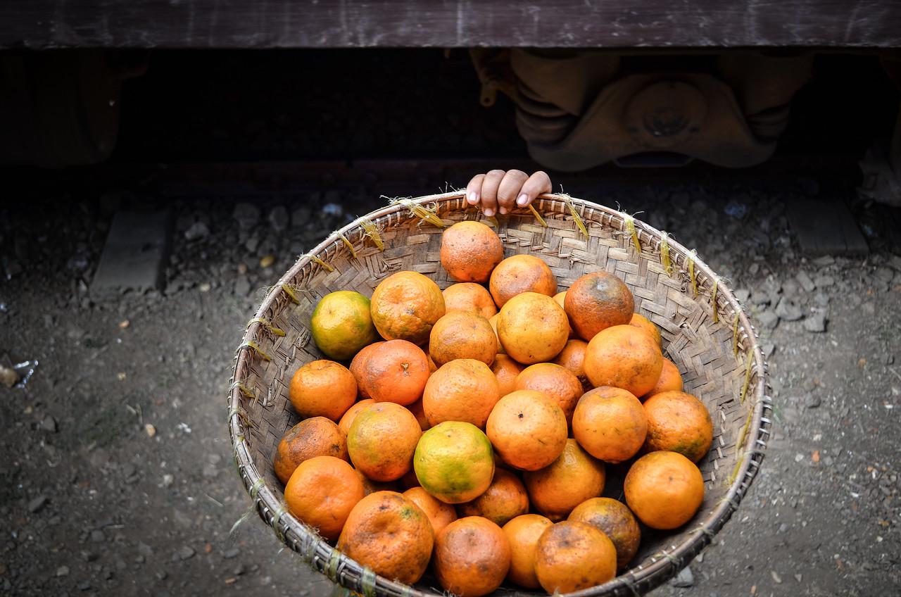 Orange seller at Kalaw train station, Burma (Myanmar)