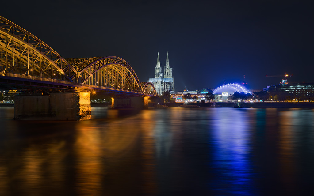 Hohenzollern Bridge in Cologne is incredible beautiful at night. It shines like gold. Photo by: Jacob Surland
