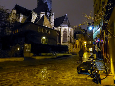 behind the church night scene on a rainy day in Paris