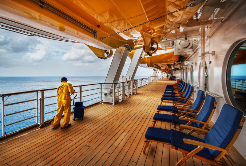 """<h2>Swabbing the Decks</h2><br/>The Disney Cruise aboard the Fantasy had deck after deck after deck – something was always happening – everywhere! It was pretty stimulating as a photographer to try to figure out where to be at different times.<br/><br/>This is the deck where the running track is. It goes around the outside of the ship, and I like to run so I was out there almost every day. I noticed around a certain time that these guys come out in yellow outfits to swab them down. So I made a point to get out there the next day and set up for this image.<br/><br/>- Trey Ratcliff<br/><br/><a href=""""http://www.stuckincustoms.com/2012/06/13/swabbing-the-decks/"""" rel=""""nofollow"""">Click here to read the entire post at the Stuck in Customs blog.</a>"""