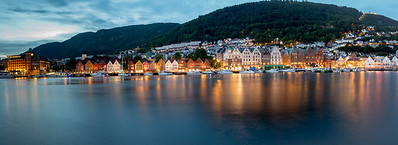 Bergen, Norway midnight harbor Panorama with Mt. Floyen in the distance