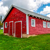 Red Outbuilding & White Farmhouse