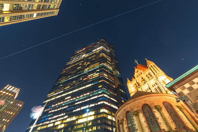 Space Station zipping over Copley Square's Trinity Church and Hancock Tower in Boston, Massachusetts.