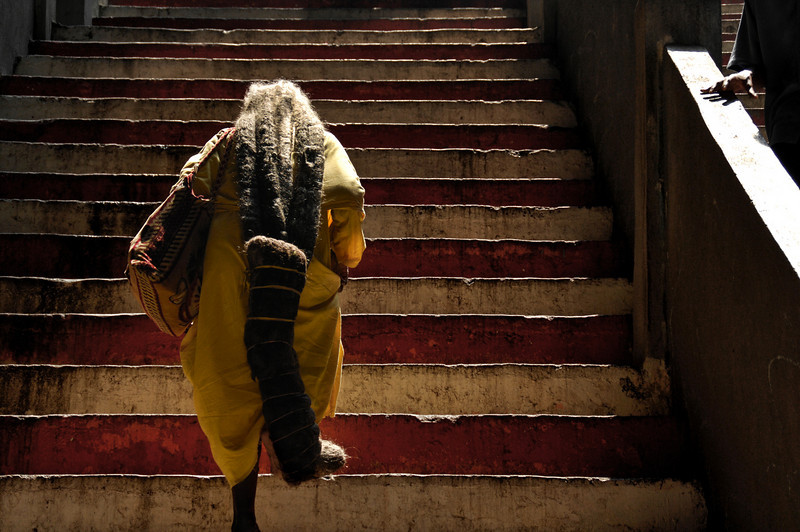 """<h2>Hindu Ascent</h2> <br/>This is a 94-year-old woman ascending the final stairs in the 272-step ascent in the Batu Caves, a pilgrimage site in Malaysia for over 800,000 Hindus per year.<br/><br/>Her hair is 3 meters long (about 9 feet). She has never cut it her entire life. It is so long, she has to fold it back and forth a few times and wrap it to keep it from dragging behind.<br/><br/>- Trey Ratcliff<br/><br/><a href=""""http://www.stuckincustoms.com/2006/08/20/hindu-ascent/"""" rel=""""nofollow"""">Click here to read the rest of this post at the Stuck in Customs blog.</a>"""