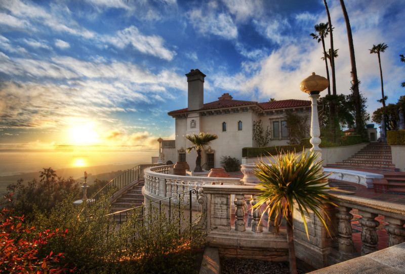 """<h2>Sunset at Hearst Castle</h2> <br/>Maybe people in California get spoiled by good sunsets.  Not living there, I don't know!  But, when you are sitting up high on a mountain, in a castle-mansion, overlooking the Pacific Ocean, how could you not get spoiled?<br/><br/>And this isn't even the main castle.  This is just one of the guest-houses.  Hearst had several guest houses there, each one as stunning as the next.<br/><br/>If you are enjoying these Hearst photos, I've now published six so far.  You can see all the <a href=""""http://www.stuckincustoms.com/category/travel/california/hearst-castle/"""">Hearst Castle Photos</a>.  Note:  These are also accessible via the """"Categories"""" down on the right side of the page.<br/><br/>- Trey Ratcliff<br/><br/><a href=""""http://www.stuckincustoms.com/2010/05/28/sunset-at-hearst-castle/"""" rel=""""nofollow"""">Click here to read the rest of this post at the Stuck in Customs blog.</a>"""
