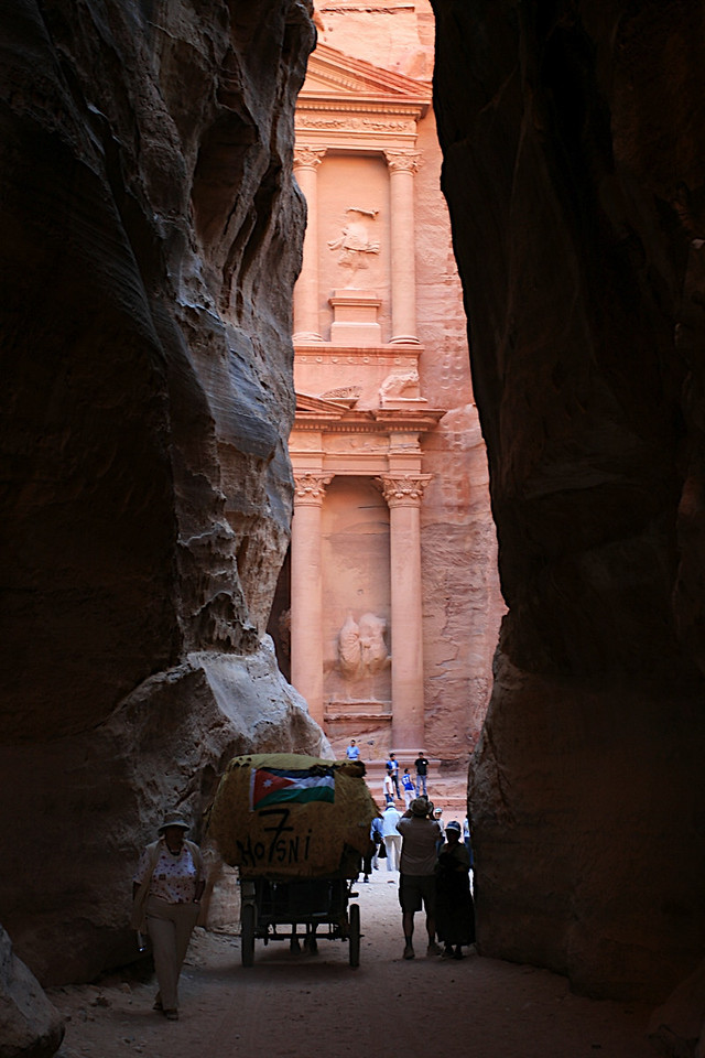Approaching the Capital in Petra, Jordan. Seeing  Petra was my main reason to journey to Jordan. It is well worth it, the amazing carvings need to be seen firsthand.<br /> An Indiana Jones style hat is suggested, but not mandatory.