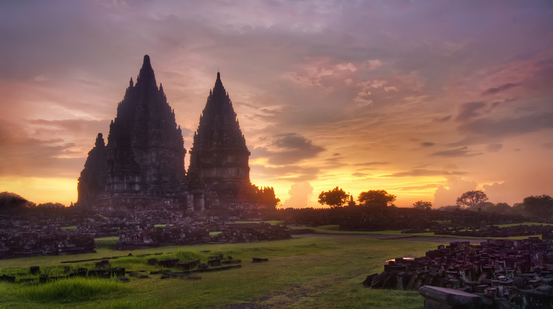 Prambanan Sunset Sometimes the lighting is best right after the sunset. And sometimes this is right when the police come to get you.  Maybe they were security guards.  But it was hard to tell in the dark - and, besides, I didn't know the difference between the clothes of a security guards and a policeman in Indonesia.  I had Will with me when these guys approached us, and he was not help at all.  He did manage to keep them busy for a while so I could take some final shots, but we could tell that we had worn out our welcome.  So then the guards started to escort us right out of there. - Trey RatcliffClick here to read the rest of this post at the Stuck in Customs blog.