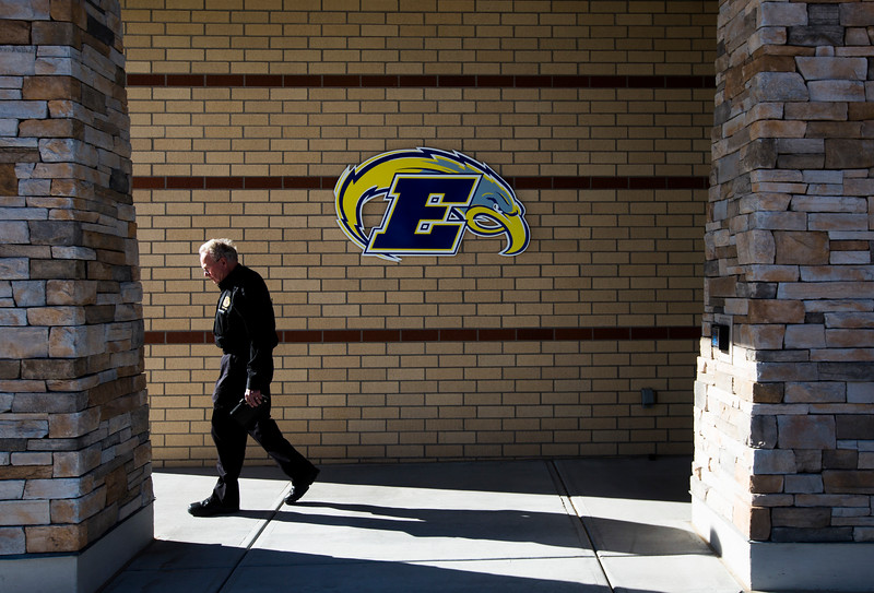 A chaplain leaves the Ellicott School District administrative offices during the first day back to school after Ellicott Middle School principal Diane Garduno was killed in a head-on collision, on Monday, November 27, 2017. Ellicott School District Superintendent Christopher Smith said that 25 counselors where available that day to help students.<br /> <br /> (The Gazette, Nadav Soroker)