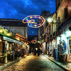 "<h2>Where the Impressionists Haunted the Streets</h2> <br/>Montmartre, in the north of Paris, is a very artsy place and I would love to open a little photography studio there, even if it is a bit touristy now.  I don't think they had neon paint-palettes hanging in the streets when it was frequented by Monet, Pissarro, Renoir, and the whole cast of bohemian characters.<br/><br/>I'm halfway through a book now called ""The Judgment of Paris"", about all these guys had to go through to get their paintings shown in the Salon.  Old-school judges would only approve paintings that showed historical scenes and the moral teachings of antiquity.  Consequently, dozens of today's priceless paintings were stamped on the back with a big red ""R"" for ""Refused"".<br/><br/>After the Impressionists' paintings were refused by the selection committee, the artists would gather at cafes here, drinking wine that tasted of ""mountwash and soot"", and lament about the state of the art, so to speak.<br/><br/>- Trey Ratcliff<br/><br/><a href=""http://www.stuckincustoms.com/2009/12/06/where-the-impressionists-haunted-the-streets/"" rel=""nofollow"">Click here to read the rest of this post at the Stuck in Customs blog.</a>"