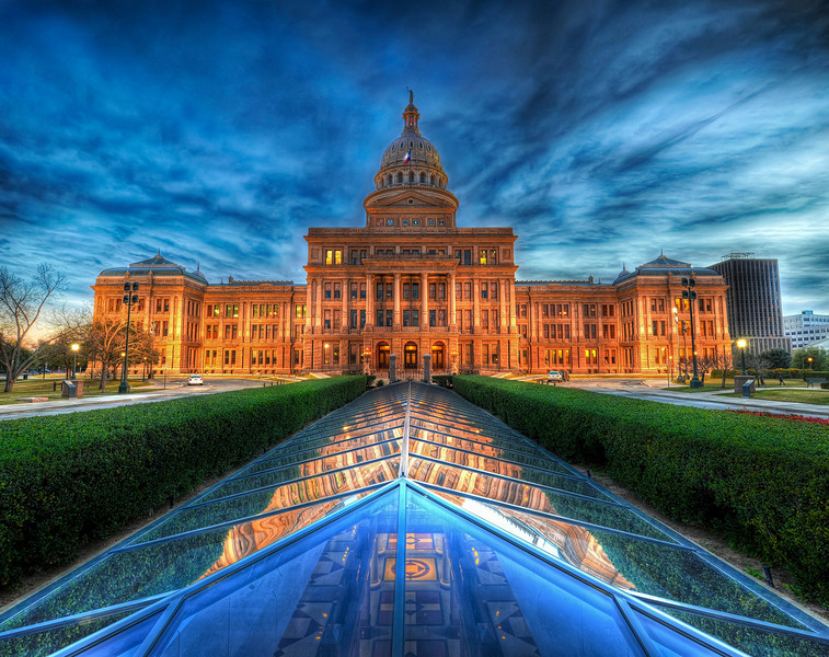 The State Capitol of Texas at Dusk I went down on Saturday evening to do some shooting around Austin and caught the capitol around sunset.  There are all kinds of interesting things about the Texas capitol, like this cool underground Illuminati chamber you can see here, but the one thing that all Texans seem to know is that our capitol is 14 feet taller than the one in D.C.  This is a source of pride for Texans, along with the cool and trivial fact that we maintain, in our state constitution, the right to secede from the Union.The capitol is made out of this pink granite, and it gets a little pinker at night at soon as they turn on the lights, especially against the blue sky.- Trey RatcliffClick here to read the rest of this post at the Stuck in Customs blog.