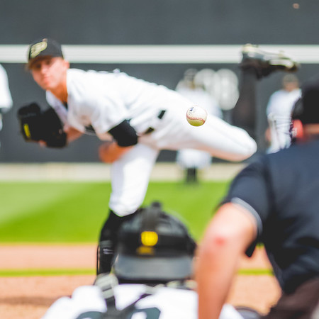 Purdue Baseball pitcher Hunter Wolfe's pitch frozen on its way to home plate.