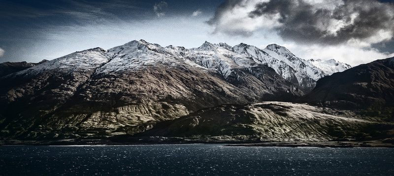 "<h2>Mountains at Lake Wanaka</h2> <br/>Now that I am getting a bit more settled in New Zealand, I've begun to make a few short road trips. We haven't found a house for sure, but we are getting pretty serious in that hunt! It's a fun process, and we have many good candidates to choose from. Once the whole family gets settled, it will make everything a bit easier with the photography!<br/><br/>A few days ago, we took a mini-road trip to Lake Wanaka. It's only about 2 hours away, and the mountains are pretty crazy. This day was extremely windy, so it took all of my manly weight to hold down the tripod when I took a short mini-hike to get this shot…<br/><br/>- Trey Ratcliff<br/><br/><a href=""http://www.stuckincustoms.com/2012/06/17/mountains-at-lake-wanaka/"" rel=""nofollow"">Click here to read the entire post at the Stuck in Customs blog.</a>"