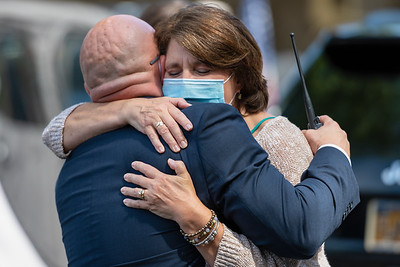 During a retirement ceremony, the outgoing Stony Brook University Police Chief's Wife hugs the incoming Chief of Police. Thanking him for a heartfelt speech and walkout ceremony. 08-11-2020