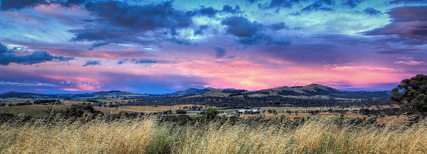 A freezing summer evening lights up the hills surrounding Mt Rogers, Canberra