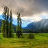 """<h2>Gentle Hills and Summer Storm in New Zealand</h2> While driving from Nelson to the south, we went through an area with many vineyards and pastoral scenes.  I mean, it doesn't get any more pastoral than this.  In fact, it's so pastoral, it's almost a time-warp and everything is in slow motion.<br><br>I stopped the car and jumped over a fence to walk out into a field to frame this shot.  I thought it might work from the road, and I was in a bit of a hurry to get this weather system before it moved along too far.<br><br>- Trey Ratcliff<br><br><a href=""""http://www.stuckincustoms.com/2012/01/20/gentle-hills-and-summer-storm-in-new-zealand/"""" rel=""""nofollow"""">Click here to read the entire post at the Stuck in Customs blog.</a>"""