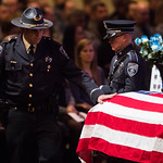 Commander Tom DeLuca places his hand on the casket for deputy Micah Flick at Flick's memorial service at New Life Church in Colorado Springs, Colo. on Saturday, February 10, 2018.<br /> <br /> (Nadav Soroker, The Gazette)