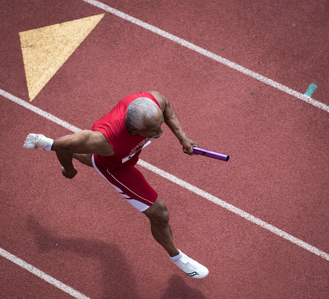 Damien Leake is running the 400 meter relay during the National Senior Games at University of St Thomas on July 13, 2015 in St Paul, Minnesota. (© Erica Jacques 2015)