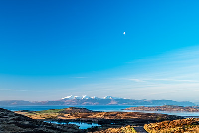 Winter Sun Reflecting on a Cold Arran & small half Moon.