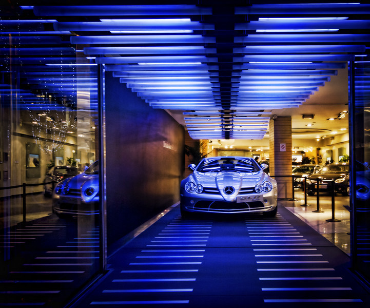 A Mercedes in Paris While walking along the Champs-Élysées in Paris, I came across this really slick Mercedes dealership.  I don't even want to think about what the lease for this space is...  but it is super cool.  I wonder if they would have let me walk in and take it out for a spin.  - Trey Ratcliff Read this entry here at the Stuck in Customs blog.