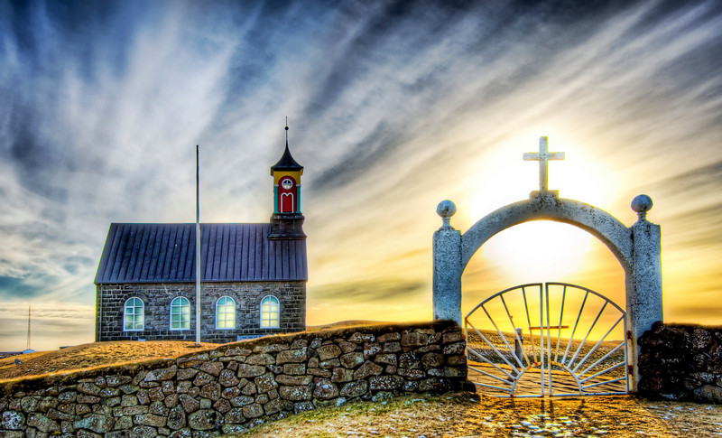 Another Sunday in Iceland This is a really nice little church by a graveyard in the south of Iceland. It was pretty much out in the middle of nowhere, as you can tell. The gate with the cross on the top leads to a tiny and lonely graveyard.- Trey RatcliffClick here to read the rest of this post at the Stuck in Customs blog.