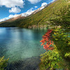 "<h2>Circumnavigating the Lake</h2> <br/>This is yet another glacier-filled lake in the mountains between Chile & Argentina. I got up pretty high on a short hike to get this shot. I had seen this bright tuft of red leaves and wanted to work it into the final product. We were on the edge of autumn and a few leaves were starting to change colors. Most of the leaves were not in any interesting compositional angles or were impossible to get near! So this one took a bit of a hike to find and set up…<br/><br/>- Trey Ratcliff<br/><br/><a href=""http://www.stuckincustoms.com/2009/08/11/circumnavigating-the-lake/"" rel=""nofollow"">Click here to read the rest of this post at the Stuck in Customs blog.</a>"