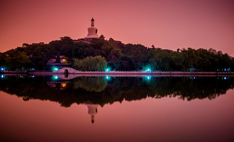 """<h2>Beihei Park Island in Beijing</h2> <br/>It was a beautiful and still night when we arrived. This park is quite huge and it can take well over an hour to walk around the whole island, so there wasn't a lot of time to catch a good location for the setting sun. Luckily, Tom had been to this spot before, so we were able to quickly get in position. Good sunsets are really rare in Beijing because of all the smog, but this evening came out nicely because of a strange pink-purple light that burned through the smog/fog as the sun set. <br/><br/>- Trey Ratcliff<br/><br/><a href=""""http://www.stuckincustoms.com/2013/06/13/baihei-park-island-in-beijing/"""" rel=""""nofollow"""">Click here to read the rest of this post at the Stuck in Customs blog.</a>"""