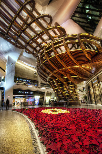 """<h2>The Consumer Tube</h2> <br/>This is one of the new shopping areas in Las Vegas inside the City Center. At the time I shot this, the mall had just opened and many of the stores had not yet been completed...  but the architecture was all in place and it was impressive from so many angles.<br/><br/>While I was there, I saw another dude with a tripod setup.  I like seeing other photographers around with tripods... I always give them a brotherly nod of approval.<br/><br/>- Trey Ratcliff<br/><br/><a href=""""http://www.stuckincustoms.com/2010/04/13/the-consumer-tube/"""" rel=""""nofollow"""">Click here to read the rest of this post at the Stuck in Customs blog.</a>"""
