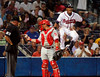 Umpire Rick Reed, left, and Phillies catcher Carlos Ruiz, #51, center, (cq) exchange balls as Braves' Yunel Escobar, right, reacts to a call during the game against Phillies on Tuesday, Sept. 4, 2007.   Phillies win 5-2.  (JENNI GIRTMAN/AJC STAFF)