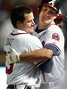 060516 - ATLANTA, GA -- The Atlanta Braves' Matt Diaz, left, (cq) celebrates with Ryan Langerhans, right, #18, (cq) after Diaz brings in the winning run against the Florida Marlins on Tuesday, May 16, 2006 in the second game of the series. Braves win 4-3 in extra innings. (JENNI GIRTMAN/AJC staff)