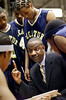 At the half of the boys AA championship, Decatur High School's head coach Carter Wilson, front, coach his team, including Nicholas Jelks, #20, back left, Bryan Cole, center, #4, and Perry Moore, back right, #50 on Friday, March 8, 2002, at the Macon Colisum. Wilkinson High School beat Decatur 64-45.