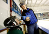 071202 - ALPHARETTA,  GA -  While coaching the Scorpions hockey team, Tom Glavine (cq) helps his son Peyton Glavine, 8, front, (cq) with a drink of water Sunday, Dec. 2, 2007.   (JENNI GIRTMAN/STAFF)