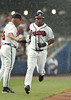 060703 - Atlanta, GA - After hitting the second home run of the game, coach Fredi Gonzalez, left, (cq) congratulates Edgar Renteria, #11, right, (cq) as he rounds the bases against the St. Louis Cardinals on Monday, July 3, 2006 before a rain delay after the third inning. Cardinals 3 Braves 2.  (JENNI GIRTMAN/STAFF)