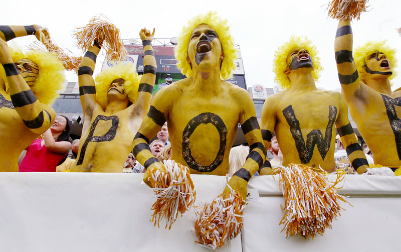 Spelling out 'JACKET POWER!' in the end zone, Georgia Tech fans Corey Tomala, 19, from left,  Barry DeMott, 19, Marc Duran, 23, Ben Beattie, 22, and Brian Fosse, 21, far right,  cheer for a Tech touchdown during their home opener against Auburn on Saturday, Sept. 6, 2003.